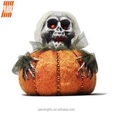 Fashion all saints orange small pumpkin with a horrible skull hold it