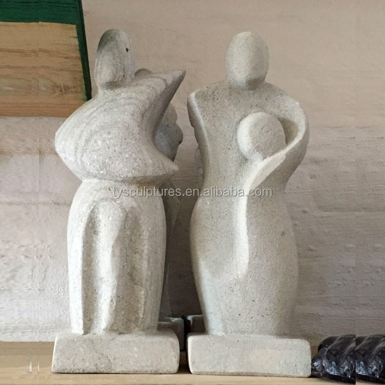 Happy holy family statue artisan crafted abstract stone father mother and children