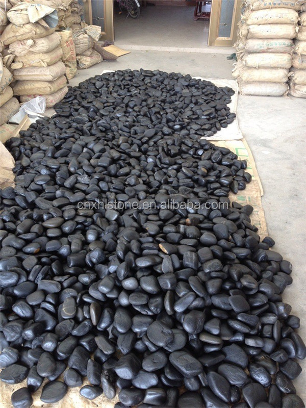 China Cheaper Round Stone Black paving stone /river stone/cobbles