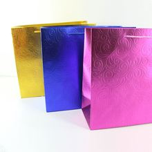 New arrival trendy style recyclable colorful glitter embossed gift packing tote paper bags