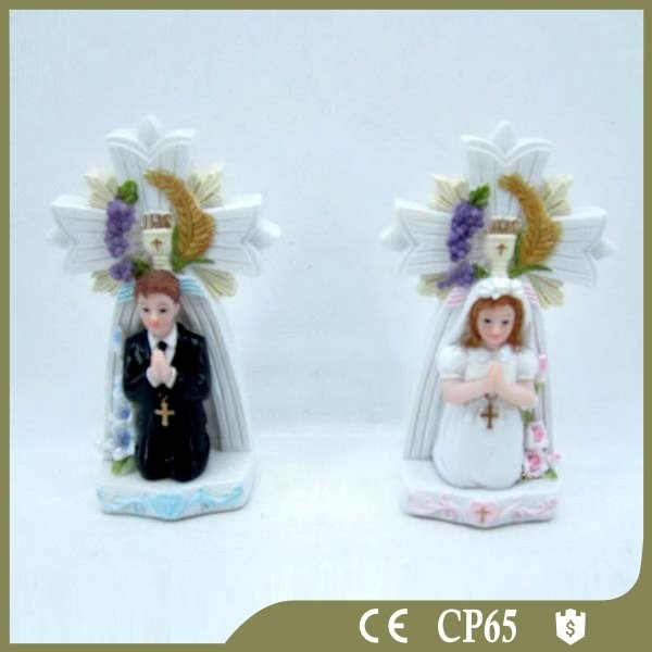 Polyresin communion boy and girl cake decoration