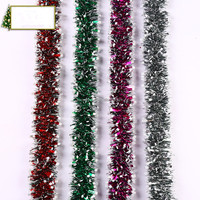 Shiny decorative tinsel garland for XMAS