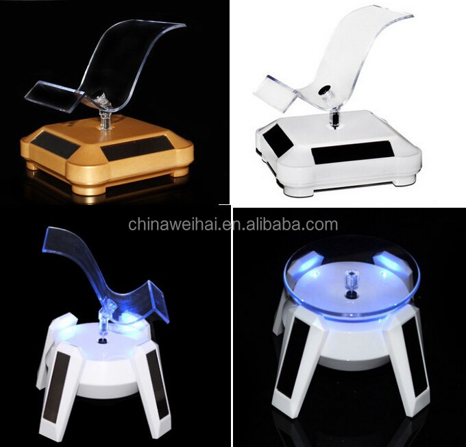 360 Degree rotable white solar energy auto rotating display mobile phone holder