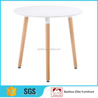 White MDF indoor and outdoor table with wood legs