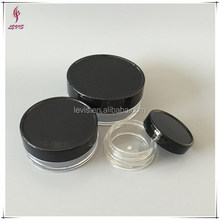 Round empty plastic foundation cosmetics container with black lid