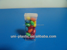Clear plastic rectangle candy container with packaging tube