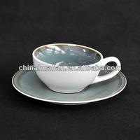 5oz reactive glazed stoneware cup & saucer with metallic rim