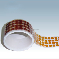 High temperature silicon adhesive polyimide dots
