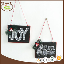 Hand work JOY wooden christmas decoration hanging on wall outside door