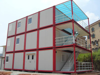 Movable and flat packed sandwich panel container house