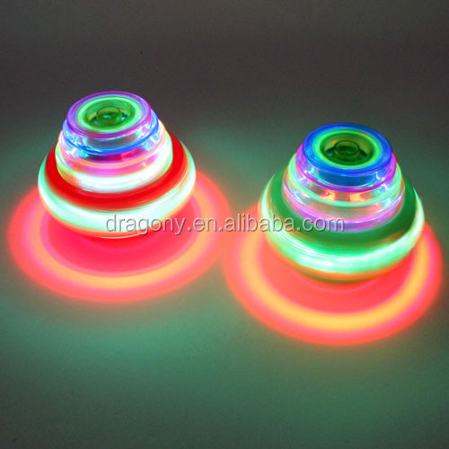 promotion kids led UFO spaceship plastic spinning top toy with flash light music gift