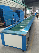 Rubber belt conveyor for shoes assembly, conveyor roller assembly line