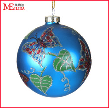 beautiful glass christmas decoration ball in blue color with butterflies and leaves