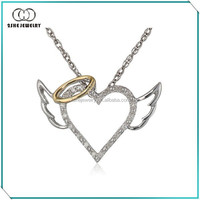 High quality 925 silver and 14k yellow gold winged halo heart pendant