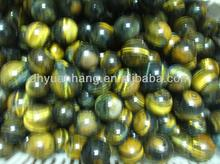 golden natural raw material charming tiger eye stone for sale,tigers eye sphere