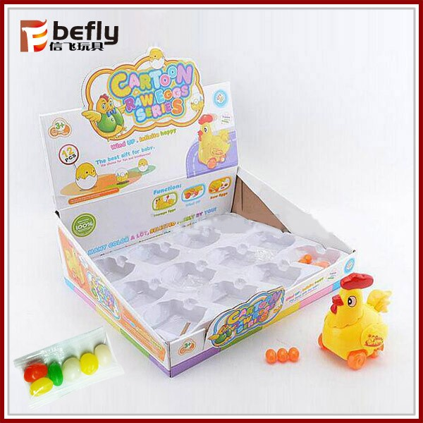 Lovely wind up chicken that lays eggs toy with candy