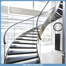 Interior curved stair with stainless steel stringer glass railing