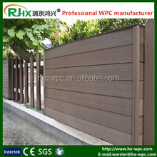 Wood plastic composite wall cladding for modern gates and fences in garden or walkway