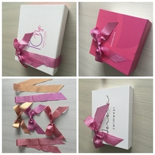 Christmas day gift decorations metallic ribbon bow on gift box , looks stretchable and shiny