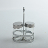 Glass spice jar with oil and vinegar bottle, salt and pepper jar and rack
