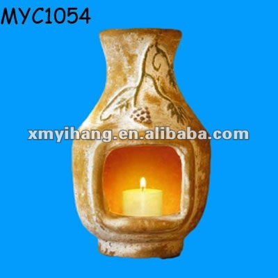 Clay candle indoor chiminea