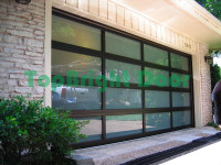 Guagnzhou manufacturers automatic sectional overhead glass garage low prices doors