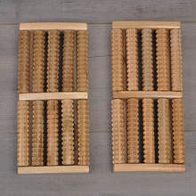 The factory sells wooden foot massor five rows of solid wood roller foot massage