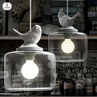 Caren dining room contemporary resin bird with clear glass pendant lamp