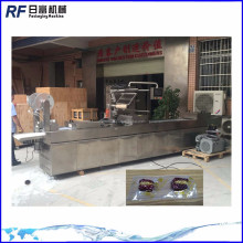 Vacuum thermoforming filling sealing machine