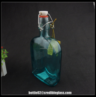 trade assurance glass bottle/ vintage design and blue tint flip-cap flask
