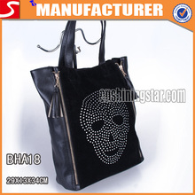 European black flannel and PU rhinestone skull handbag