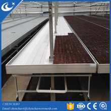 Hydroponic farm system ebb and flood trays with metal rolling benches
