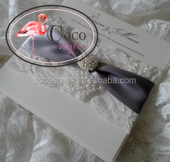 luxury lace invitation with brooch and ribbon