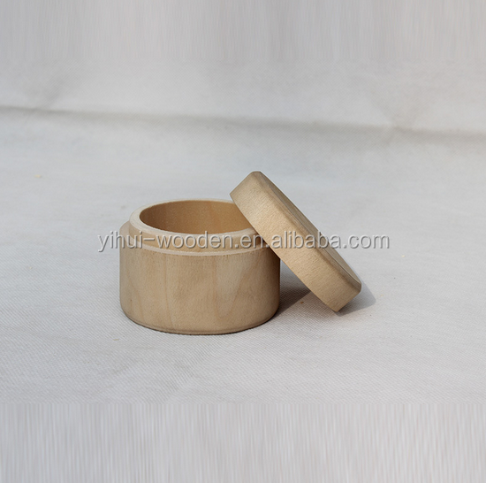 small round wooden box for rings