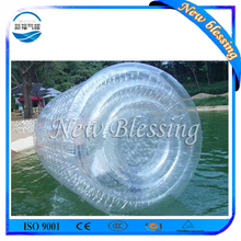 Person inside inflatable balls ride, walk on water ball