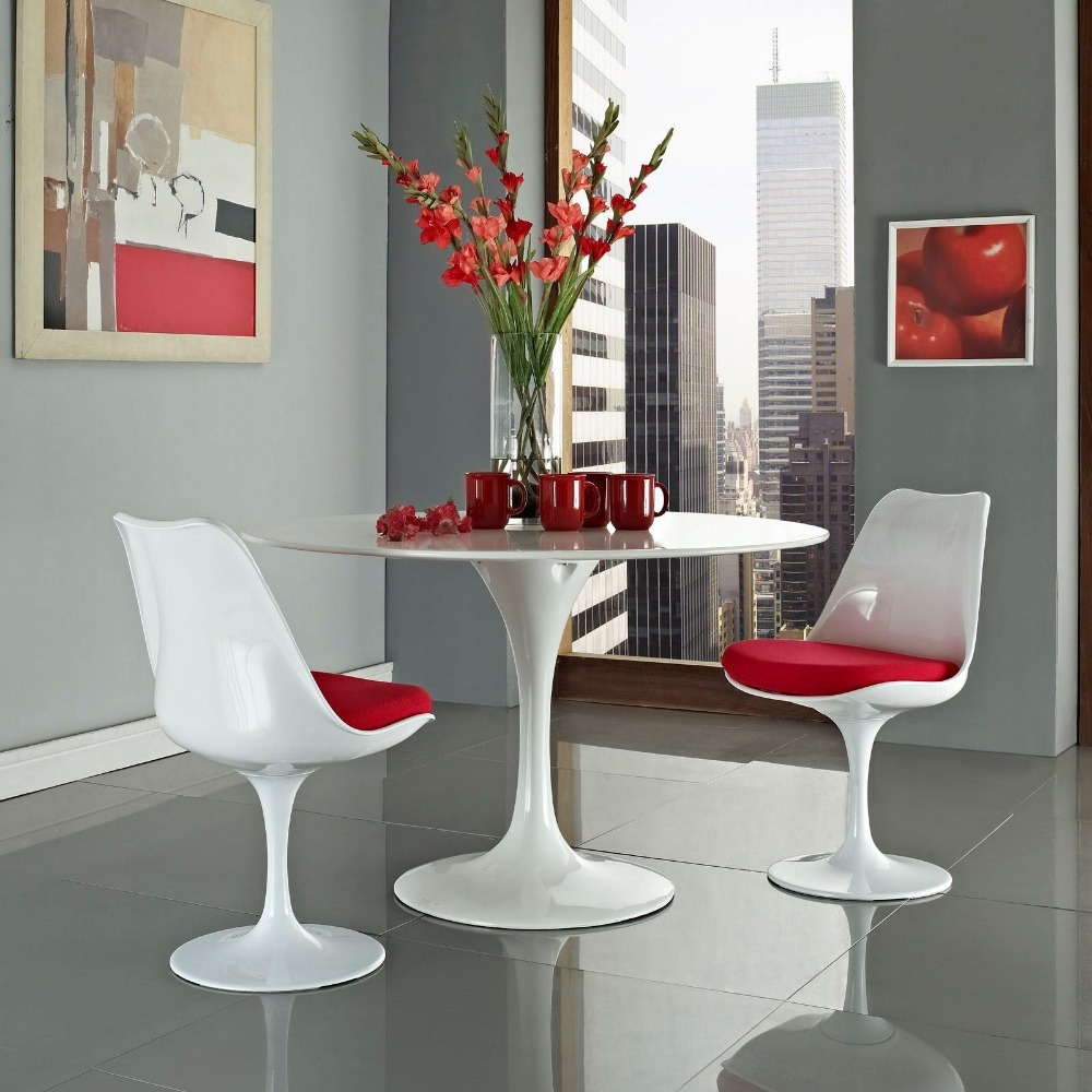 Mid century modern design molded plastic side chair with red cushion