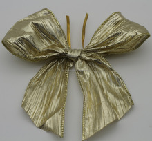 Large gold twist tie gift ribbon bow with wired border