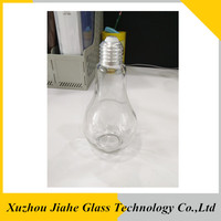 empty light lamp bulb drink bottle glass beverage bottle with metal lid