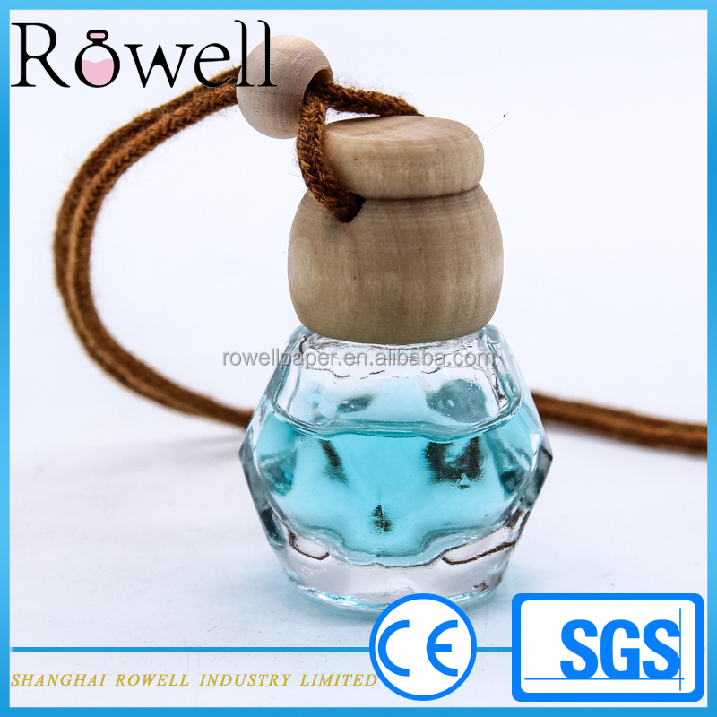 special design 9ml hanging auto perfume packaging 10ml car diffuser glass bottle with wood cap