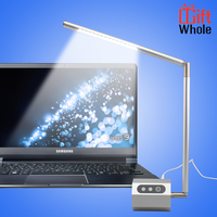 Silver flexible arm bed reading led lamp on the desk