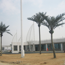 Artificial palm tree with bent trunk