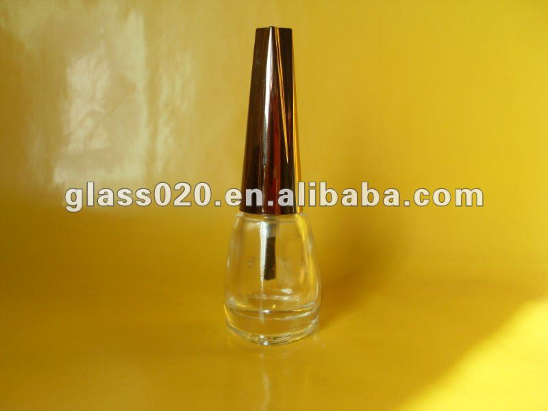shiny clear nail polish bottle set with sharp metal cap and black brush