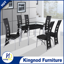 checker glass dining table designs four chairs ( tempered glass , metal legs )