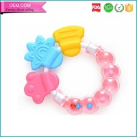 From china factory baby chewy ECO-friendly silicone rattle teether toys