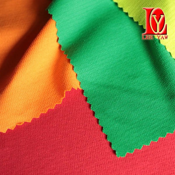 Cotton interlock fabric made of supima and polyester with wicking treatment