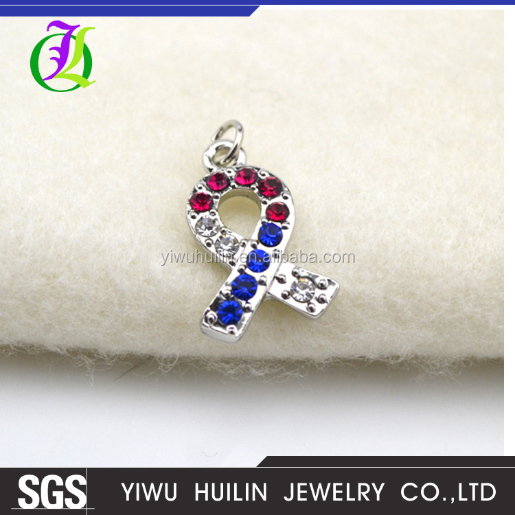 DSC 0229 Yiwu Huilin jewelry Hot Selling metal autism multicolor crystal ribbon pendant charm