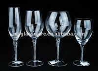clear blown champagne and wine glass with swirl in the stem