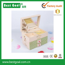 Light green wooden jewelry box with mirror and small drawers