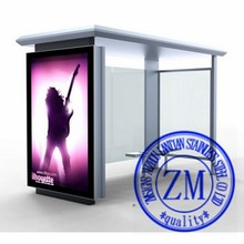 Metal bus stop shelter with advertising light box