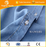 popular super soft indigo shiny tencel denim fabric price made in china